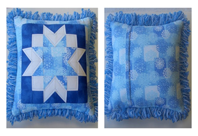 Quilted Star pillow with fringe