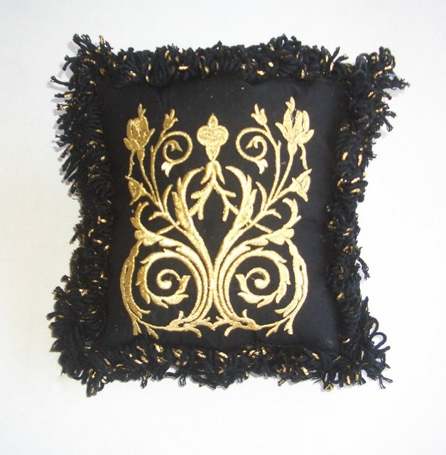 Classic Black pillow with embroidery and bold embellishing!